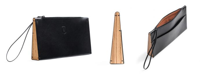 The black leather Apis Clutch bag with wooden detailing