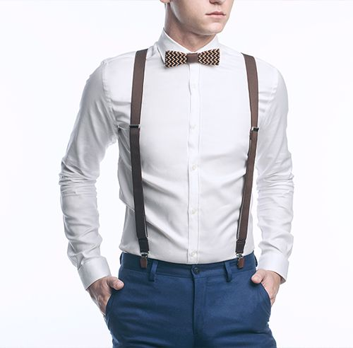A man wearing a shirt with a wooden bow tie and stylish men's shorts