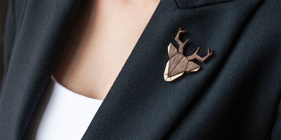 BeWooden - A woman in a jacket with the wooden brooch Deer Brooch
