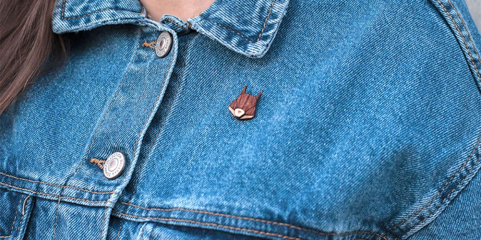 BeWooden - A woman in jeans jacket with the wooden brooch Squirrel Brooch