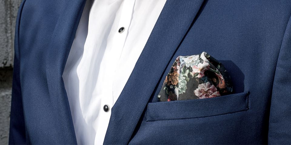 Man in a blue jacket with floral square Roses