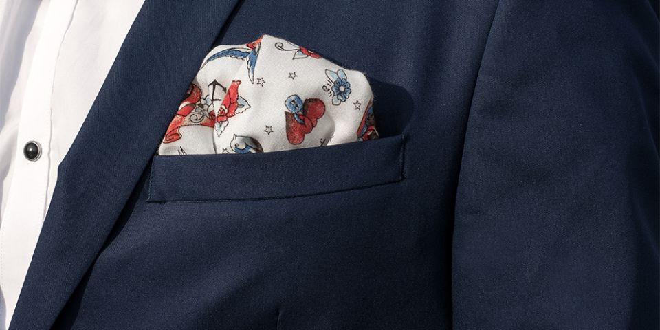 Man in a blue jacket with Hearts square