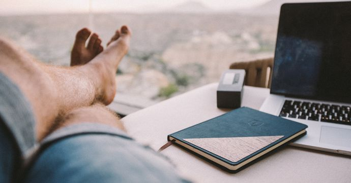 A man at the table with the BeWooden Ocean Notebook