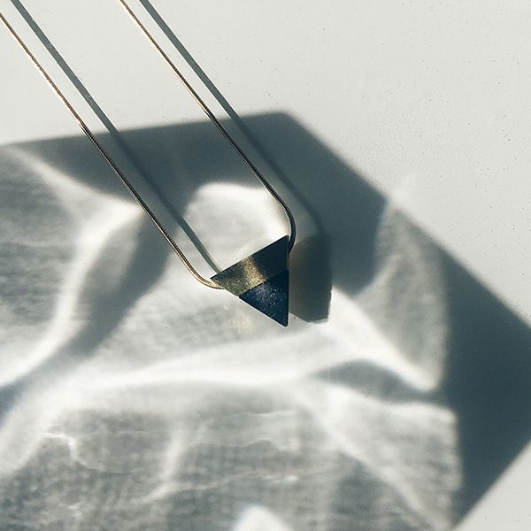 A silver jewellery with wooden details