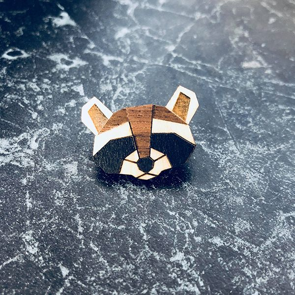 The wooden raccoon brooch