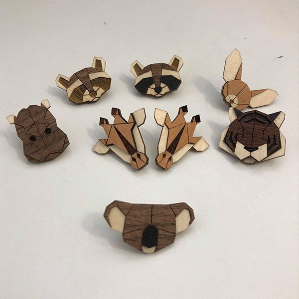 Wooden brooches with animal motifs